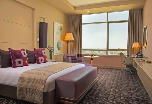 Habitación Club Rotana – cama king size